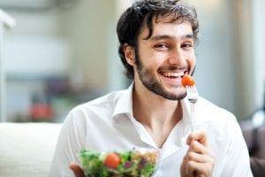 Young man eating a healthy salad-img-blog