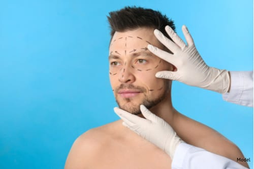 Doctor examining mans face before Endoscopic Brow Lift