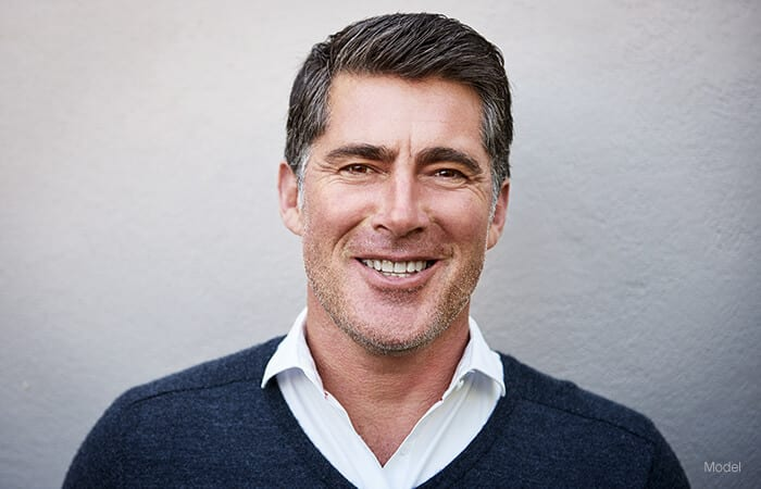 male model smiling for neck lift