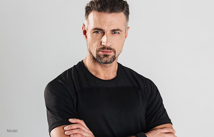 male model wearing a black shirt facing forward for vertical facelift